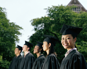 Row of graduates, focus on female graduate smiling